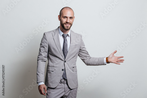 Deurstickers Ontspanning Portrait of a successful businessman in a suit, business coach / consulting. Studio shot with a flipchart on a white background.