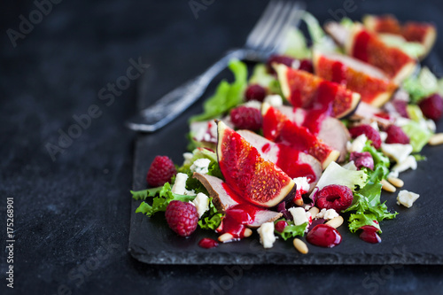 Fotografie, Obraz  Delicious salad with fresh figs, duck meat and raspberry sauce