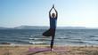 male yogi doing yoga on the coast