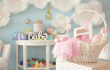 Wicker Basket With Gifts For B...