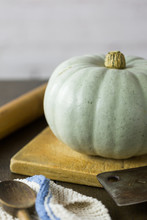 Whole Crown Prince Pumpkin With A Blue Grey Skin On Kitchen Table