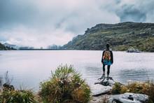 Hiker In A Mountain Overlookin...