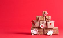 Collection Of Christmas Present Boxes On A Red Background
