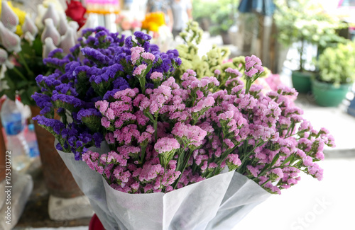 Valokuvatapetti Bunch of colorful statice flower at local store for sell at On Nut, Bangkok, Tha