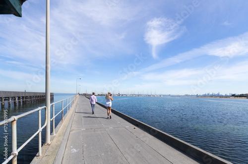 Tourists on Brighton pier Poster