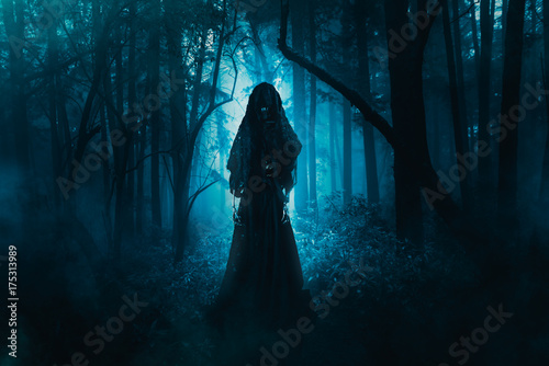 Photo scary ghost lurking in the woods / high contrast image