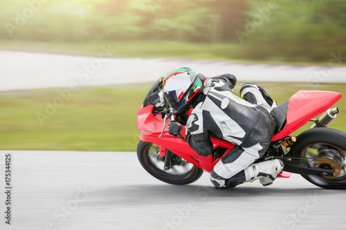 Poster Motorise Motorcycle practice leaning into a fast corner on track.