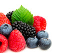 Close-up arrangement with mixed, assorted berries including blackberries, strawberry, blueberry and raspberries and fresh leaf isolated on white. Colorful, healthy concept. Black, blue, red, green