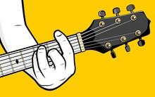 Man Hand Playing Guitar D Chord