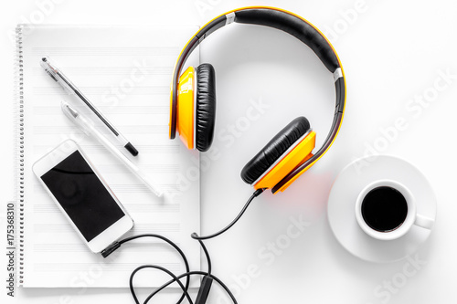 Fototapeta Compose music. Headphones, music notes, phone and coffee on white background top view obraz na płótnie