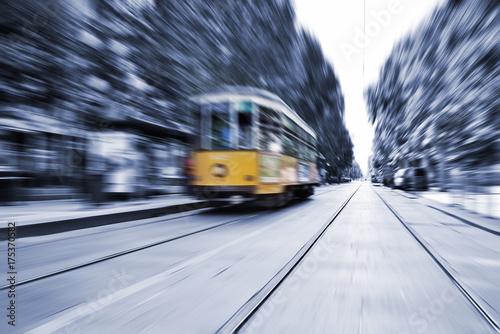 Garden Poster Milan Blurred movement of a Old vintage orange tram