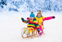Kids Play In Snow. Winter Slei...