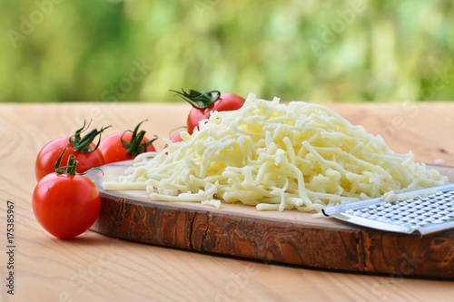 Grated mozzarella cheese and cherry tomatoes