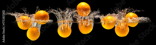 Group of fresh fruits falling in water