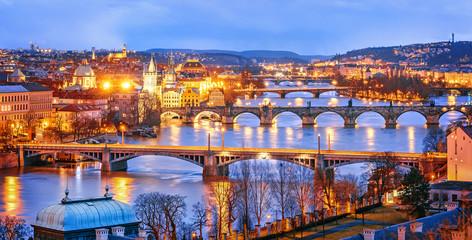 Fototapeta Classic view of Prague at Twilight, panorama of Bridges on Vltava, view from above, beautiful bridges vista. Winter scenery. Prague is famous and extremely popular travel destination. Czech Republic.