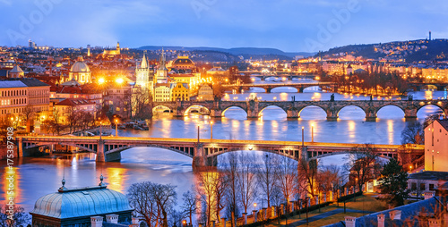 Prague Classic view of Prague at Twilight, panorama of Bridges on Vltava, view from above, beautiful bridges vista. Winter scenery. Prague is famous and extremely popular travel destination. Czech Republic.