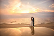 canvas print picture - Bride and groom, newlyweds, honeymoon on the beach sunset sun