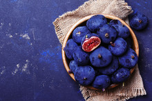 Raw Blue Figs In Bowl On Stone...