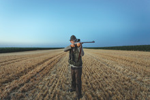 Hunter Aims In Field With His ...