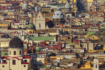 Fototapeta Italy. Historic Centre of Naples (UNESCO World Heritage Site) seen from Castle Sant'Elmo. There are cupolas of some churches located along the Tribunali street (incl. the facade of Naples Cathedral)