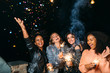 canvas print picture Group of young women celebrating new years eve outdoors, throwing confetti