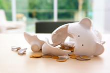 Broken Piggy Bank With Coins O...