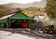 Retro Steam Train Departs From The Railway Station In The UK Snowdon