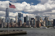 Urban new york american landscape with skyscrapers and usa flag