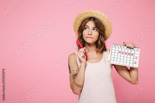 Cuadros en Lienzo Portrait of a pensive young girl in summer hat