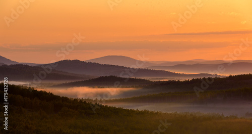Wall Murals Cappuccino Beautiful landscape at sunrise with foggy hills