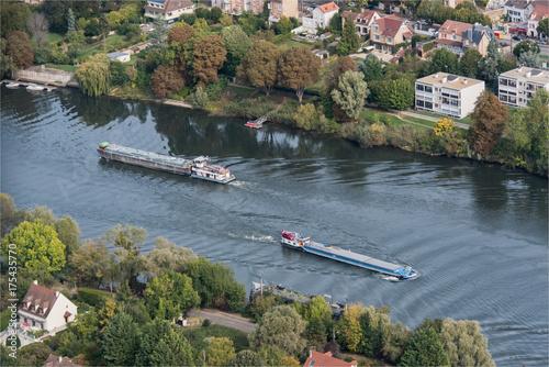 Fotografie, Obraz  Vue aérienne de péniches sur la Seine à Triel sur Seine à l'ouest de Paris