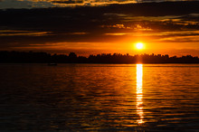 Silhouette Of The Boat On River Dnieper At Sunset