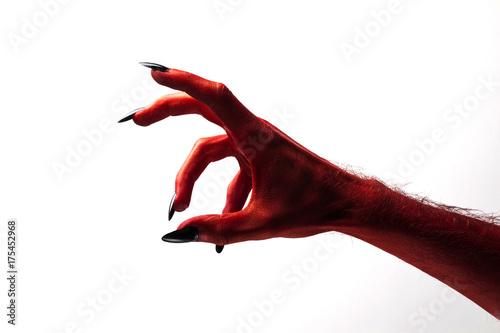Halloween red devil monster hand with black fingernails against a plain backgrou Poster Mural XXL