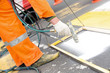 canvas print picture - Man worker remarking pedestrian crossing lines on asphalt surface with paint sprayer gun equipment