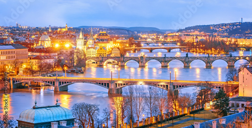 Spoed Foto op Canvas Praag Classic view of Prague at Twilight, panorama of Bridges on Vltava, view from above, beautiful bridges vista. Winter scenery. Prague is famous and extremely popular travel destination. Czech Republic.