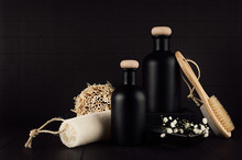 Cosmetics Mock Up -  Blank Black Bottles, Bath Accessories, White Flowers On Dark Wood Board, Copy Space. Template For Advertising, Designers, Branding Identity, Cover.