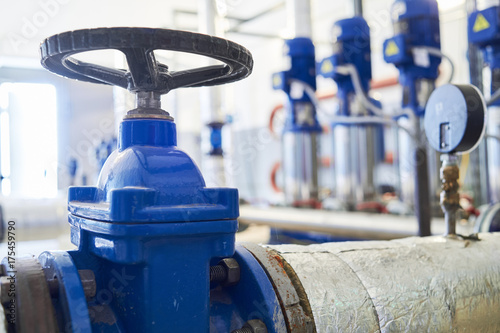 Photo  water pumping station. Valve faucet and pumps