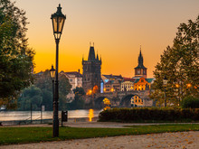 Embankment With Old Lamp In Old Town Of Prague With Charles Bridge And Vltava River. Early Morning Shot. Prague, Czech Republic.