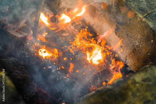 Fotografie, Obraz  Hot sparking live-coals burning in a barbecue