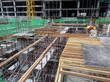 Timber form work and steel reinforcement bar fabricated by construction workers at construction site