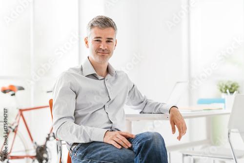 Fotografie, Obraz  Confident businessman sitting in his office