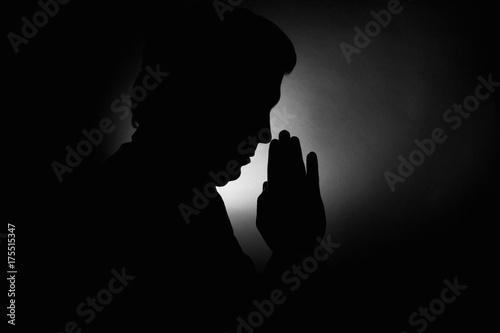 Fotografie, Obraz  Praying silhouette man