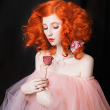 Red-haired Girl With Pale Skin...