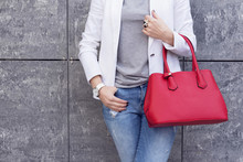 Casual Woman In White Jacket With Red Bag In Hand Street Look