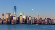 Lower Manhattan Skyline and moon rising at blue hour, NYC, USA