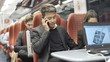 Cheerful young businessman talking on the phone on busy commuter train