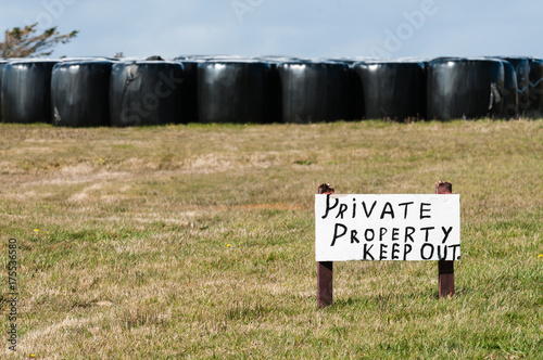 """Poster  Sign in a field saying """"Private property.  Keep out"""""""