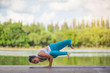 asian woman practice Yoga beside the river