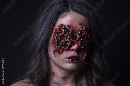 Photo  Girl with realistic sores and worms in her eyes