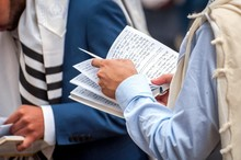 Prayer. The Jewish Hasid Reads A Religious Book. Close-up Of A Book And Hands.